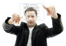 Programador que trabaja con una pantalla táctil Imagen de archivo