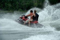 Programas pilotos de motocicleta del agua Imagenes de archivo