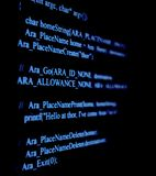 Programm Code. Blue programm code on black background Royalty Free Stock Photos