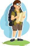 Programma di strada della lettura del ragazzo di viaggiatore con zaino e sacco a pelo Immagine Stock Libera da Diritti