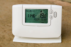Programmable central heating thermostat will reduce energy costs. Reducing the central heating temperature by just a degree using a programmable thermostat can Stock Images