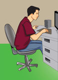 Programmer. Sitting in front of his computer Stock Photo