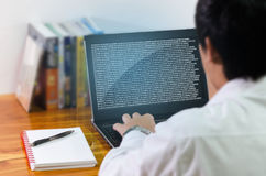 Programmer coding on computer stock images