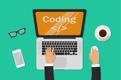 Programmer coding on laptop computer on work desk, freelancer sitting on working table and typing code on keyboard top. View, web development process concept Royalty Free Stock Photos
