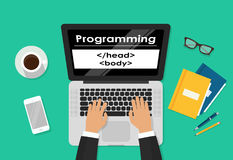 Programmer coding on laptop computer on work desk, freelancer sitting on working table and typing code on keyboard top. View, web development process concept Royalty Free Stock Images