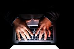 Programmer or computer hacker typing code on laptop keyboard Royalty Free Stock Photography