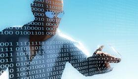 Programmer editing binary code. A man poking his finger into a binary sheet Royalty Free Stock Photos