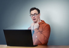 Programmer in glasses with laptop. Deep Fear Royalty Free Stock Images