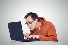 Programmer with laptop Royalty Free Stock Images