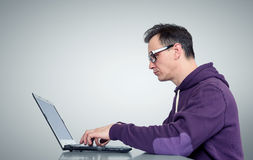 Programmer with laptop on background Stock Photo