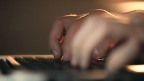 Programmer`s hands typing commands on laptop keyboard. Extremely close-up refocusing shot of programmer`s hands typing commands on laptop keyboard. Man using stock video