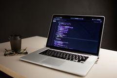 Programmer`s workplace, laptop with project code. Development of websites and applications stock photography