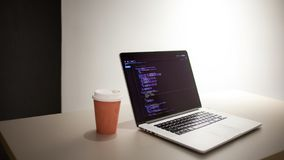 Programmer`s workplace, laptop with project code. Development of websites and applications stock images