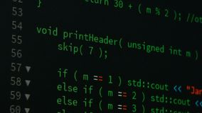 Programmer scrolling up and down and checking code for editing futuristic technology concept with grain and dark tone processed.  stock footage
