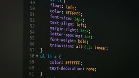 Programmer scrolling up and down for editing page of html css website code editor stock footage
