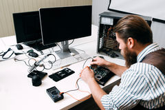 Programmer testing new electronic equipment Stock Photos
