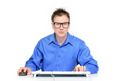 Programmer at work on white background Royalty Free Stock Photos
