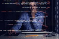 Programmer working with programming code on computer screen. In dark room Royalty Free Stock Photos
