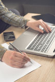 Programmer writing notes on paper Royalty Free Stock Images