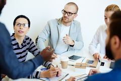 Programmers brainstorming in boardroom Stock Photos