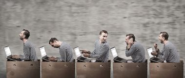 Programmers in cell boxes in the office. Office coveyer concept Royalty Free Stock Photos
