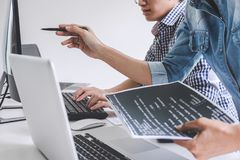 Programmers cooperating at Developing programming and website working in a software develop company office, writing codes and. Typing data code royalty free stock photos