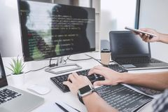 Programmers cooperating at Developing programming and website working in a software develop company office, writing codes and. Typing data code stock image