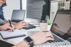 Programmers cooperating at Developing programming and website working in a software develop company office, writing codes and royalty free stock photos