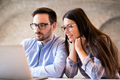 Programmers cooperating at information technology company. Programmers cooperating at IT company developing apps Royalty Free Stock Image