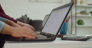 IT programmers typing lines of HTML code on laptops. Closeup of male hands of freelance it programmers typing lines of HTML code on laptop. Busy creative web stock footage