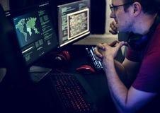Programmers working on computer program Stock Image