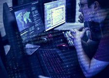 Programmers working on computer program Stock Images