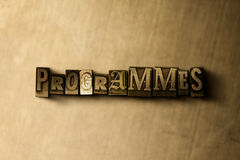 PROGRAMMES - close-up of grungy vintage typeset word on metal backdrop Royalty Free Stock Photography
