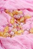 Programmes des pierres sur le rose Photos stock
