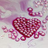 Perles en forme de coeur Photographie stock