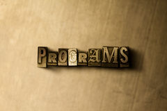 PROGRAMMES - plan rapproché de mot composé par vintage sale sur le contexte en métal image stock