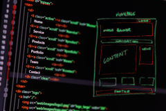 Programming code and wireframe on computer Stock Photography