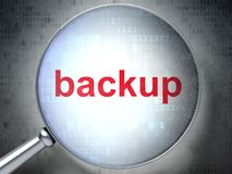 Programming concept: Backup with optical glass. Programming concept: magnifying optical glass with words Backup on digital background, 3D rendering Stock Photography