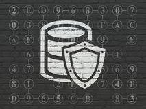Programming concept: Database With Shield on wall background. Programming concept: Painted white Database With Shield icon on Black Brick wall background with Stock Photo