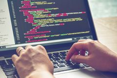 Programming Work Time. Programmer Typing New Lines of HTML Code. Laptop and Hand Closeup. royalty free stock photo