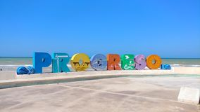 Progreso letters sign, Progreso, Mexico. Progreso letters sign on the beach in Progreso, Mexico. Located at a mere 45 minutes of Merida at the north west of the Stock Photo