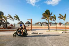People rest on a beach in Progreso near Merida, Yucatan, Mexico Stock Photography