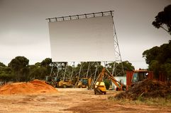 Removing old outdoor movie screen Royalty Free Stock Images