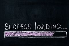 Progress bar loading success, for business and career. A loading bar isolated on a blackboard indicate a success improvement Stock Photo