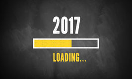 Progress bar showing loading of 2017. On a blackboard Royalty Free Stock Image