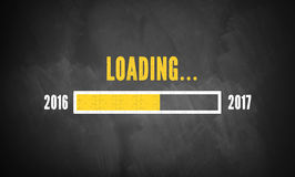Progress bar showing loading of 2017. On a chalkboard Royalty Free Stock Images