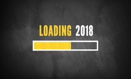 Progress bar showing loading of 2018. On a blackboard stock illustration