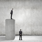 Progress in business. Businessman standing on bar and looking down at colleague Royalty Free Stock Photos