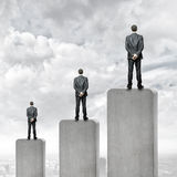 Progress in business. Rear view of three businessman standing on bar Royalty Free Stock Photography