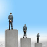 Progress in business. Rear view of three businessman standing on bar Stock Photos
